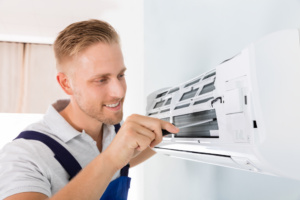 Technician Repairing AC - Heating and Cooling Mesa AZ